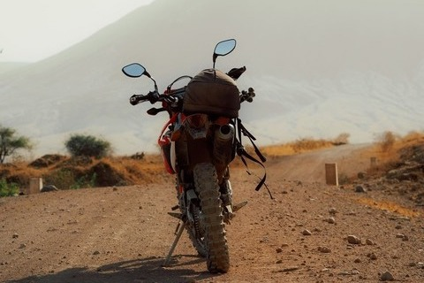 motorcycle tour to Africa Tanzania motorbike dusty road