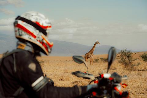 motorcycle tour to Africa Tanzania biker giraffe